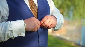 Man Buttoning Waistcoat Preparing to Wedding Groom stock footage