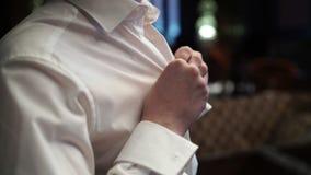 Man buttoning white shirt stock footage