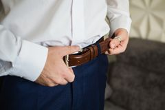 Man buttons belt. Men`s style. Professions. To prepare for work Stock Photos