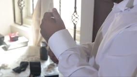 man buttons up white wedding shirt cuffs with cufflinks stock video footage