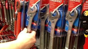 Man buying adjustable wrench stock footage