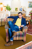 Man buying armchair in furniture store Royalty Free Stock Images