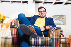 Man buying armchair in furniture store Stock Images