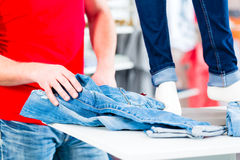 Man buying blue jeans Stock Photo