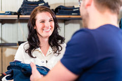 Man buying  blue jeans in shop Stock Photos