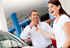 Man buying a car for his wife Stock Photo