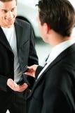 Man buying car - key being given Stock Photos
