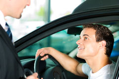 Man buying car from salespersonv Stock Image