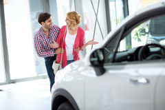 Man buying car to his wife Royalty Free Stock Image