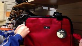 Man buying cat travel tote bag stock video