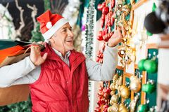Man Buying Christmas Ornaments At Store Stock Photos