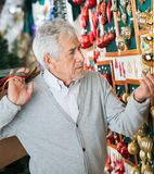 Man Buying Christmas Ornaments At Store Royalty Free Stock Images