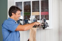 Man Buying Coffee From Vending Machine In Royalty Free Stock Images