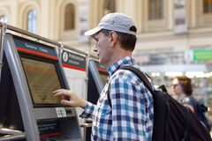 Man buying commuter train tickets. St. Petersburg, Russia - July 17, 2016: Man buying the commuter train tickets using vending machine in Baltiysky Railway Stock Photos