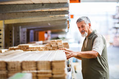 Man buying construction wood Stock Images