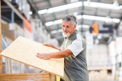 Man buying construction wood Royalty Free Stock Photos
