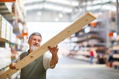 Man buying construction wood Stock Photos