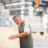 Man buying construction wood Stock Photo