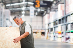 Man buying construction wood in a  DIY store Royalty Free Stock Images