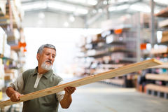 Man buying construction wood in a  DIY store Stock Photography