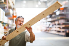 Man buying construction wood in a  DIY store Stock Images