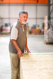 Man buying construction wood in a  DIY store Stock Photo