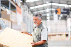 Man buying construction wood in a  DIY store Stock Image