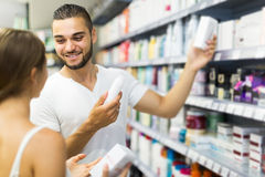 Man buying cosmetical cream in the shopping mall Stock Photography