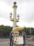 A man buying crepes from a crepes cart in Paris, France. Royalty Free Stock Images
