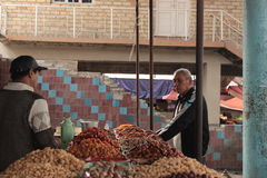 A man buying dried fruits, osh, Kyrgyzstan Royalty Free Stock Photography