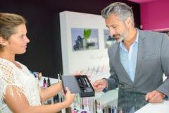 Man buying an e-cig. Man royalty free stock photos
