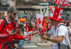 Man Buying Flags on Canada Day Stock Photography