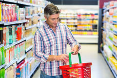Man buying food. In supermarket royalty free stock photo