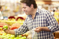 Man buying fruit in supermarket Stock Photo