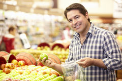 Man buying fruit in supermarket Stock Image