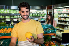 Man buying fruit in supermarket Royalty Free Stock Photo