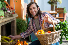 Man buying fruits and vegetables in organic shop Stock Image