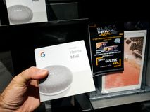 Man buying Google Home mini during Black Friday Royalty Free Stock Images