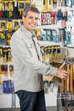 Man Buying Hammer In Hardware Store Royalty Free Stock Images