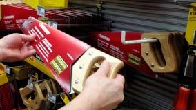 Man buying 15 inch tool box saw stock video