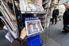 Man buying international press with Emmanuel Macron and Marine l Stock Photography