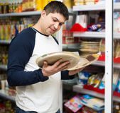 Man buying Italian pizza in cooled food section Royalty Free Stock Photo