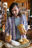Man buying loaf of bread Stock Image