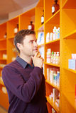 Man buying medicine in pharmacy Stock Photos