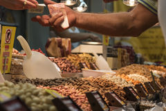 A man buying nuts. A guy buying nuts at Cyprus traditional market Royalty Free Stock Photography