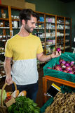Man buying onion in supermarket Stock Images
