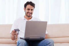 Man buying online Stock Photo