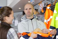 Man buying protective clothing. Man Stock Images