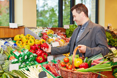 Man buying red pepper in supermarket Stock Photos