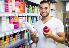 Man buying shampoo Stock Photos
